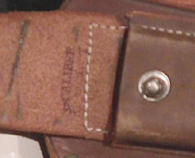 32 CALIBER COLT markings inside flap of magazine pouch.
