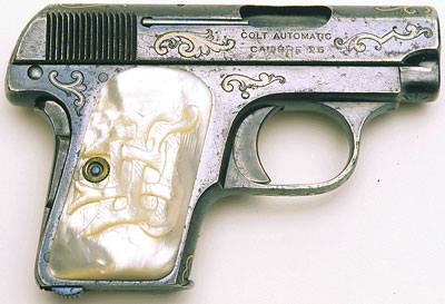 Model N Factory Gold Inlaid with Factory Carved Mother-of-Pearl Grips.