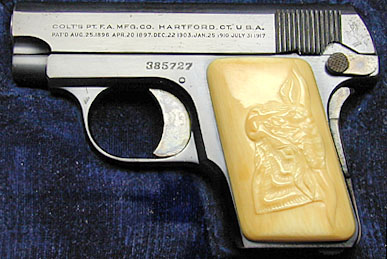 Model N with Factory Carved Steerhead Ivory grips.